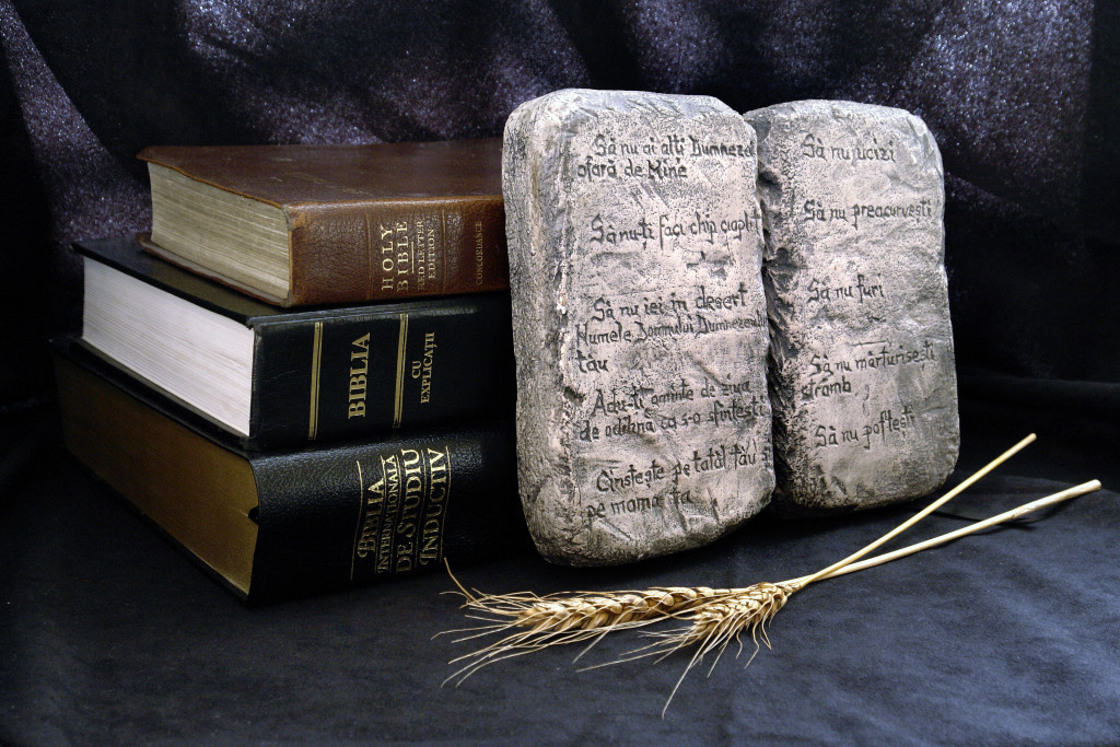 The Ten Commandments with bibles on a black background